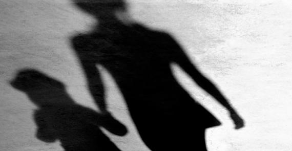 Shadows of woman holding child's hand suggest frightening and emotional memories