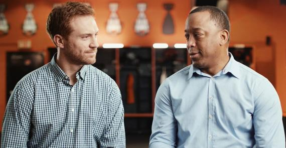 BC Lions Alumni, Travis Lulay and Geroy Simon sit together, talking about the overdose crisis in B.C.