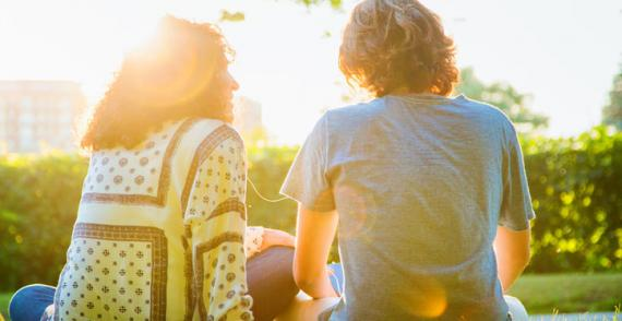 Woman supports teenage boy to discuss traumatic past experiences
