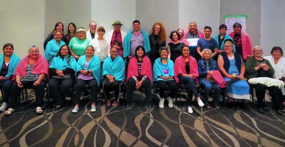 Participants smile at First Nations Health Authority Wellness Team workshop