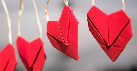 Row of paper hearts symbolize connection and compassion