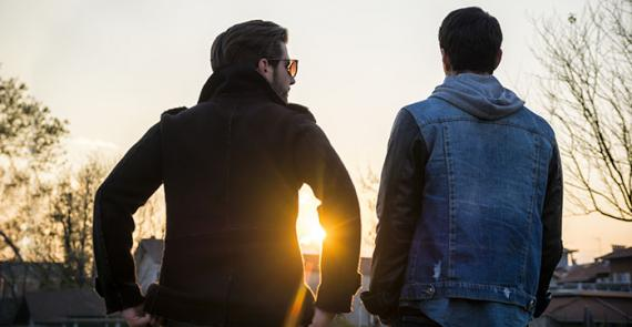 Two young men discuss and support each other through substance use challenges