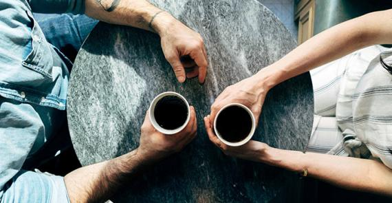 Two people have coffee and discuss substance use and addiction