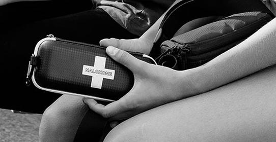 Young woman with naloxone kit prepared to respond to an overdose