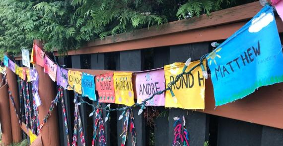 The memorial displays brightly-coloured flags with names of people who have died of overdose